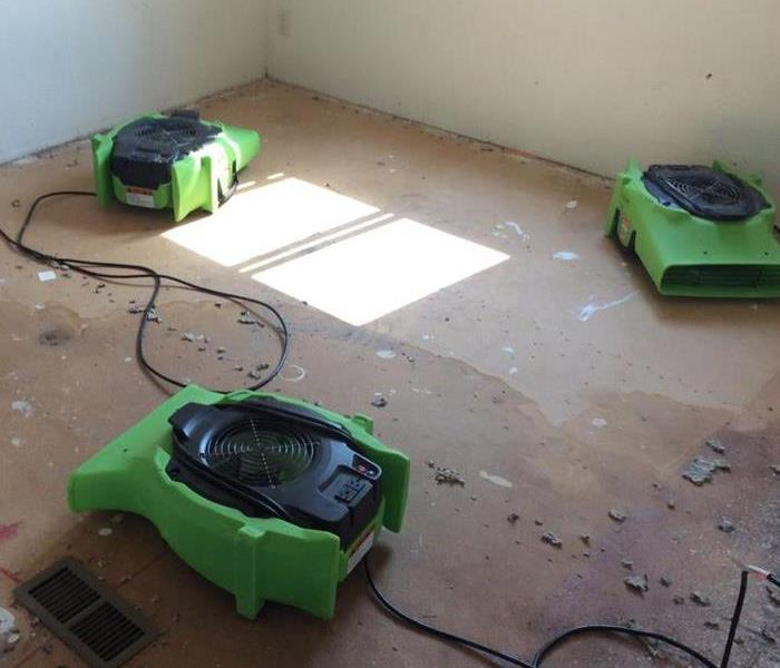 Air Movers drying out a room due to a water loss in the crawl space.