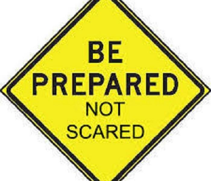 Yellow caution sign with the words Be Prepared Not Scared